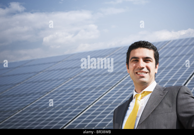 businessman in solar power station - Stock Image