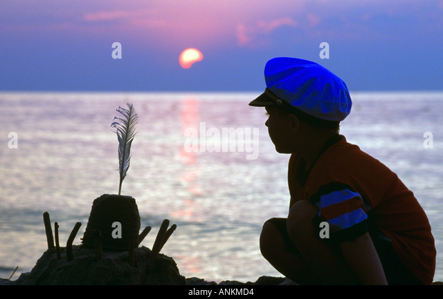 young boy beside his sandcastle at the beach of Katy Rybackie, Poland - Stock Image