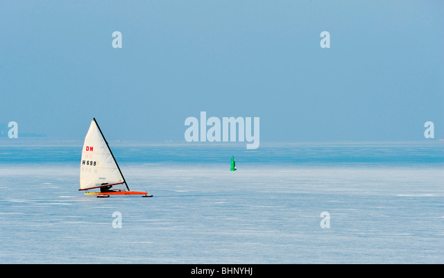 Ice sailing on the frozen lake (gouwzee Between Edam and Marken Netherlands) - Stock Image