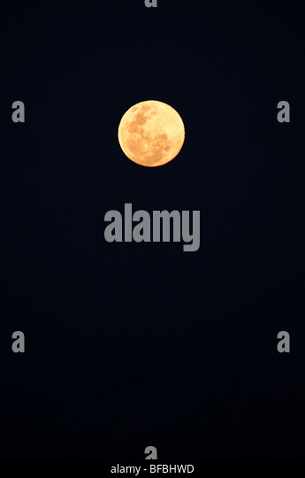 The full moon rising over the Andes Mountain Range in Santiago de Chile - Stock Image