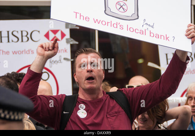 London, UK. 20th July, 2013. An anti-cuts protester shouts his message as UK Uncut hold demonstrations outside two - Stock Image