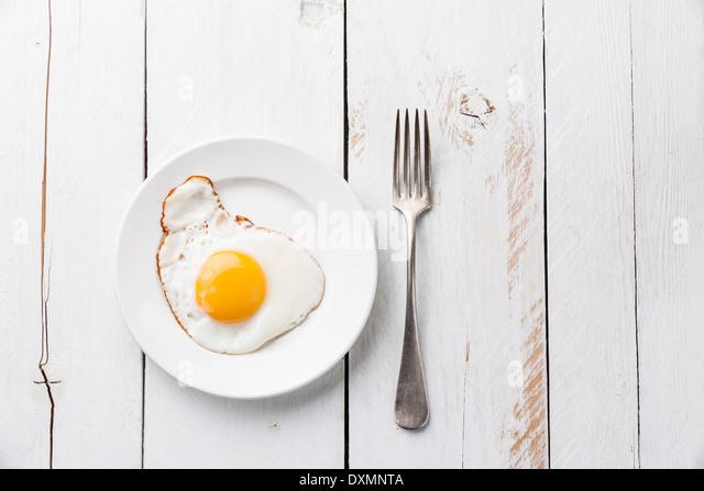 Fried egg for breakfast - Stock Image