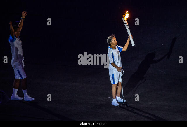 Marcia Malsar (R) holds the Paralympic torch during the Opening Ceremony of the Rio 2016 Paralympic Games, Rio de - Stock-Bilder