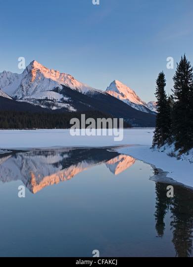 The Rocky Mountains form the backdrop for Maligne Lake, near Jasper, Alberta, Canada. - Stock Image