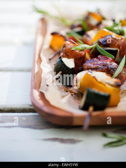 Skewers with halloumi, meat and tomato - Stock Image