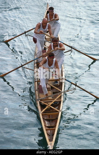 Venice. Italy. Rowing team taking part in a race during the Regata Storica Historical Regatta. - Stock Image