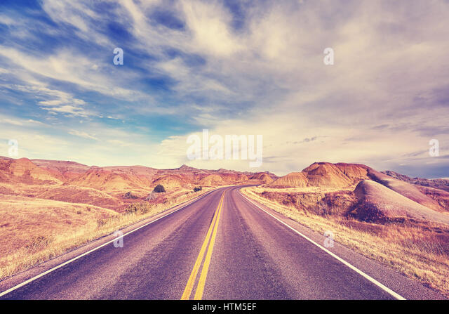 Color toned scenic road, travel background, USA. - Stock-Bilder