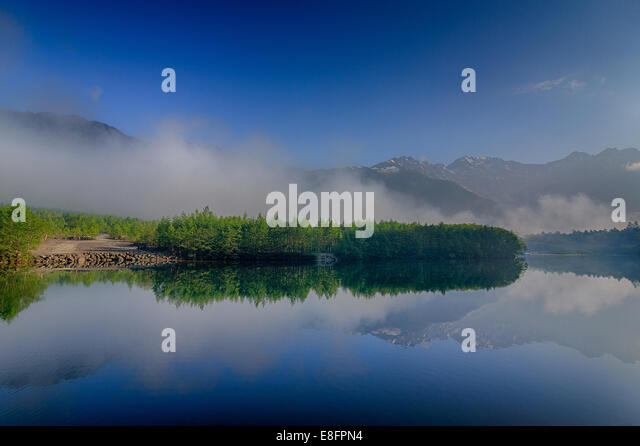Japan, Kamikochi, Tranquil landscape with lake - Stock Image