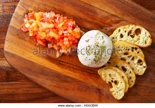 Truffle burrata with tomato bruschetta and French baguette - Stock Image