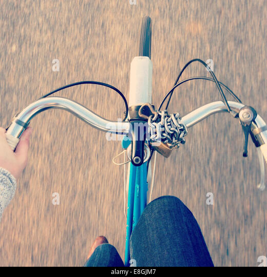 Overhead shot of handlebars while cycling - Stock Image