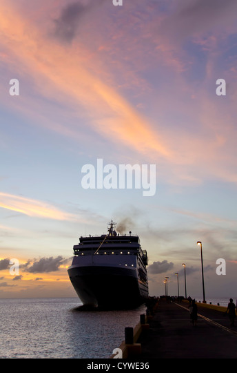 Silhouette cruise ship docked at pier at St. Croix, U.S. Virgin Islands in the Caribbean. - Stock Image