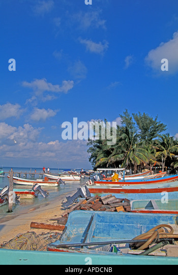 Mexico Isla Mujeres fishing boats on beach day - Stock Image