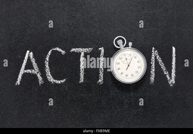action word handwritten on chalkboard with vintage precise stopwatch used instead of O - Stock Image