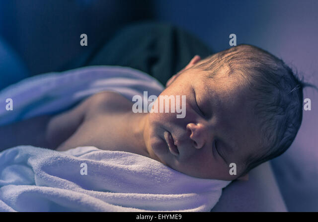New born baby sleeping - Stock Image