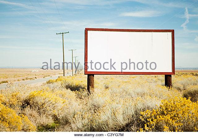 Blank billboard at roadside - Stock Image
