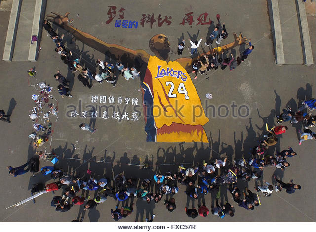 Shenyang, China. 14th April, 2016. Students pose for group picture with a big portrait of Kobe Bryant of the Los - Stock Image