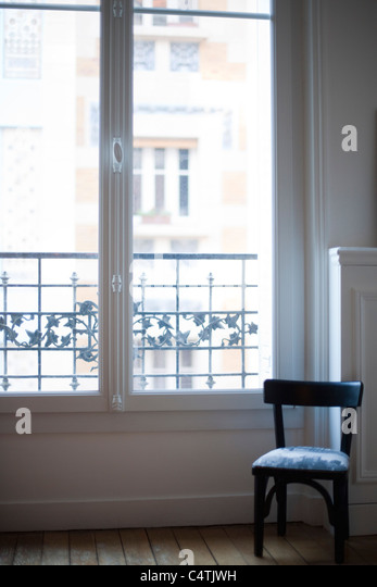 Chair by window - Stock Image