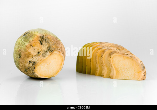 Fresh yellow turnip with some slices of it - Stock Image