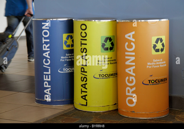 Panama City Panama Aeropuerto Tocumen airport PTY terminal recycling bins green movement paper plastic organic waste - Stock Image