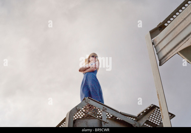 woman standing on train - Stock Image