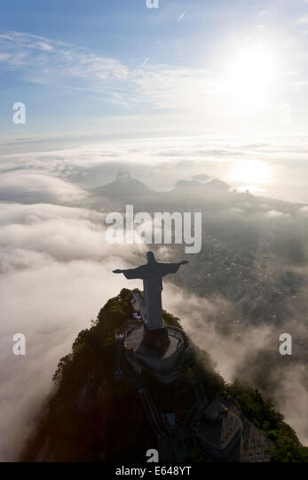 The giant Art Deco statue Jesus known as Cristo Redentor (Christ Redeemer) on Corcovado mountain in Rio de Janeiro - Stock Image