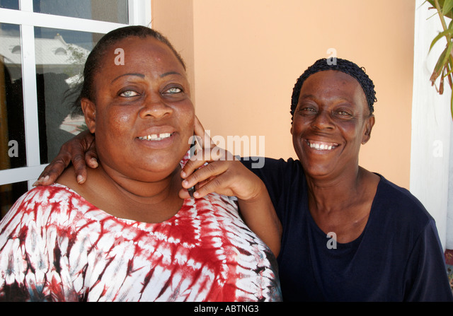 Grand Turk Cockburn Town Cruise Ship Center Black women smiling - Stock Image
