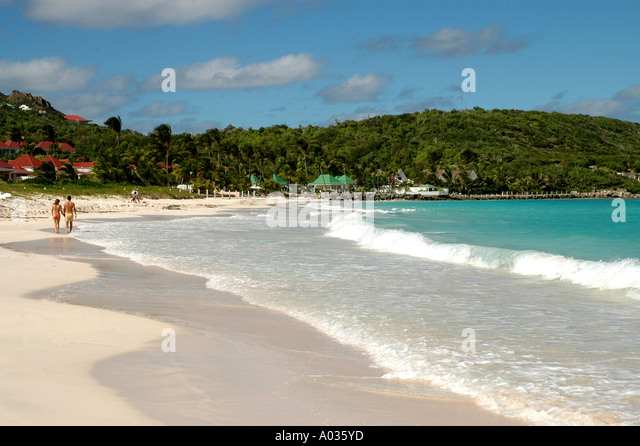 Couple walking beach at  Saint Barth  st jeans beach St Barts st bart saint barthelemy st barts - Stock Image