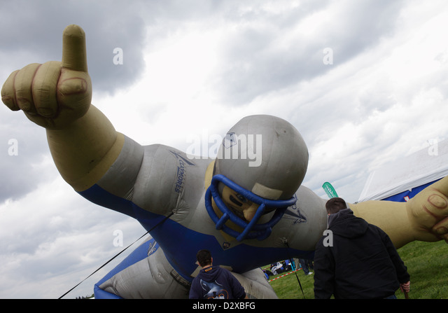 Berlin, Germany, giant inflated doll in the form of an American Football player - Stock Image