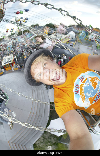 crazy man in chairoplane on Cranger Kirmes, Germany, North Rhine-Westphalia, Ruhr Area, Herne - Stock Image