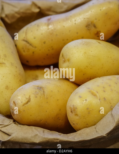 New Potatoes In A Paper Bag - Stock Image