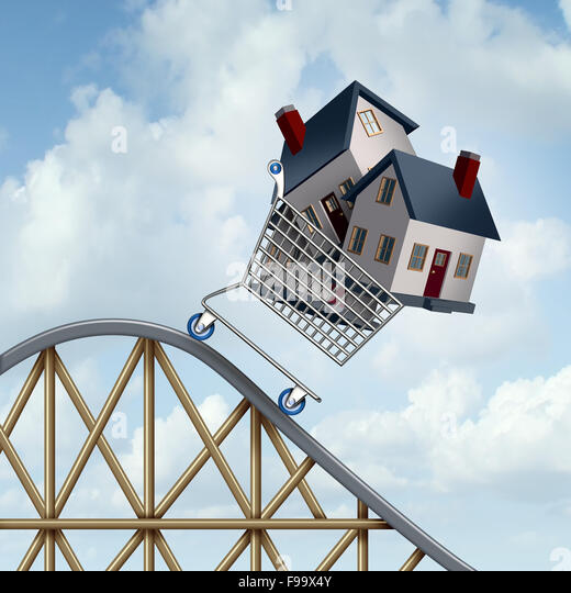 Falling home prices and declining real estate value financial concept as sold houses in a shopping cart going down - Stock Image