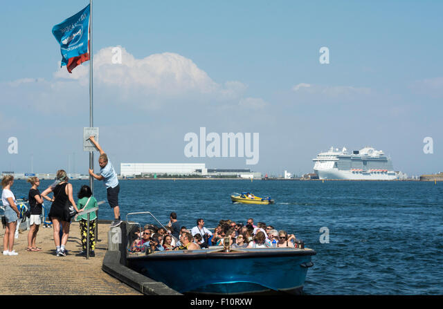 Luxury cruise ship and tourist boats in Copenhagen, Denmark, - Stock Image