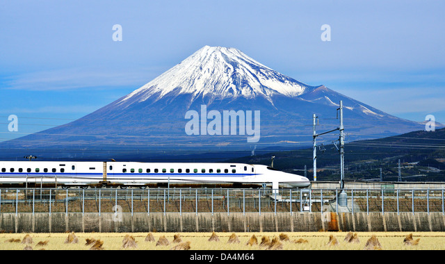 A bullet train passes below Mt. Fuji in Japan. - Stock-Bilder