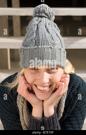 Young woman wearing knit hat - Stock Image