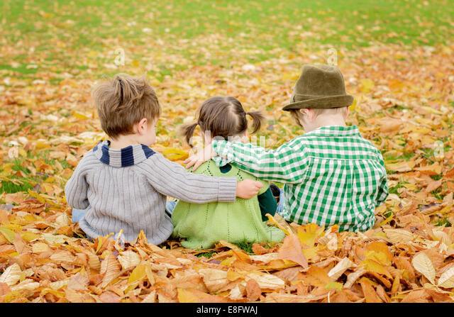 Three children ( 2-3, 4-5 ) hugging - Stock Image