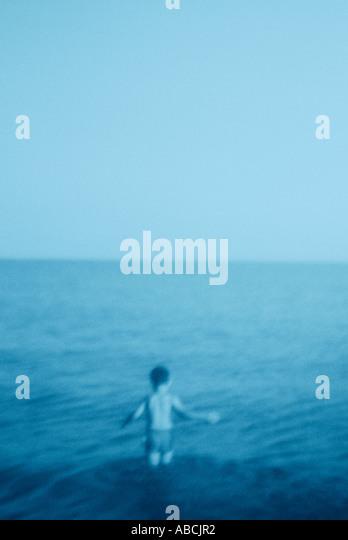 Young boy wading into the sea (cyanotype) - Stock-Bilder