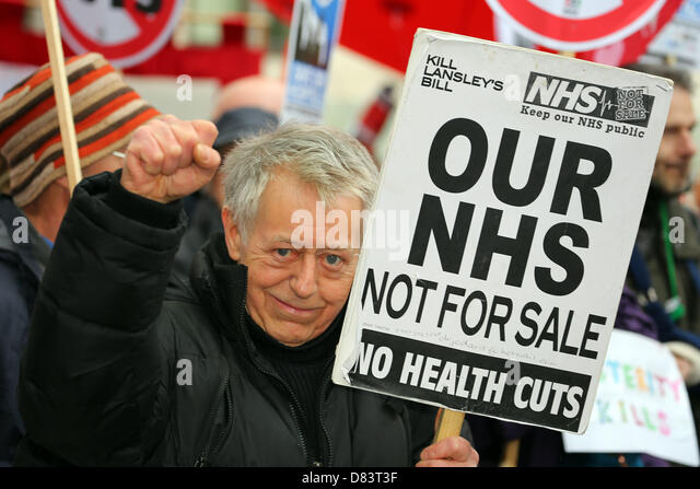 London, UK. 18th May 2013. Protestors with placards and banners supporting the National Health Service against cuts - Stock Image
