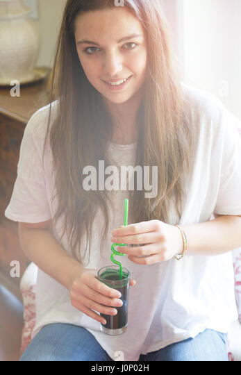 Young woman with refreshing drink - Stock Image