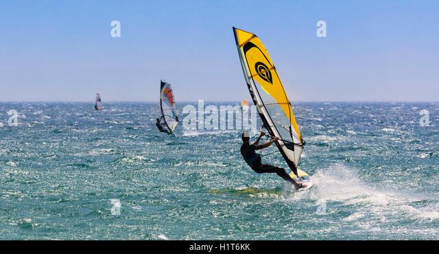Tarifa, Costa de la Luz, Cadiz Province, Andalusia, southern Spain.  Windsurfing. Tarifa is nicknamed the Wind Capital - Stock Image