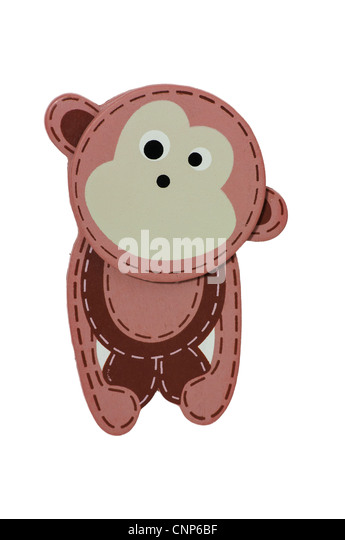 Cut out of a brown, toy monkey on a white background - Stock Image
