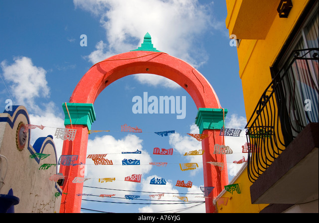 Cozumel Mexico San Miguel town shopping plaza red arch - Stock Image