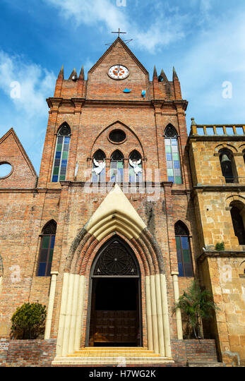 Brick church in the small town of Valle de San Jose in Santander, Colombia - Stock Image