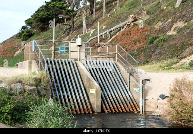 Sluice gates at Loe Bar beach river overflow drainage channel near Helston in Cornwall, UK - Stock Image
