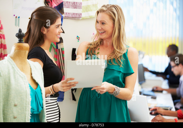 Two Women Meeting In Fashion Design Studio - Stock Image
