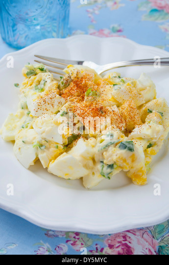Above View of Homemade Organic Egg Salad on White Plate with Fork - Stock Image