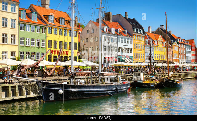 Copenhagen old town, Denmark - the boat in Nyhavn Canal - Stock Image