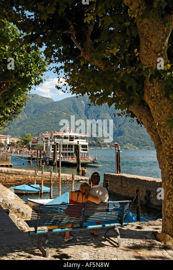 Switzerland Ticino Ascona Lago Maggiore Ferry pier couple on - Stock Image