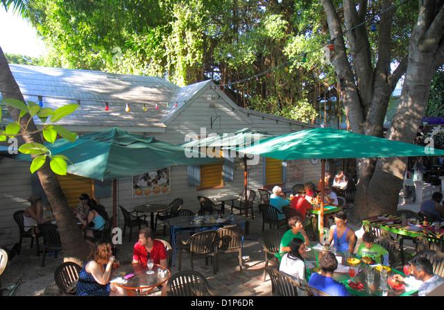 Florida Key West Florida Keys Bahamas Village Petronia Street Blue Heaven restaurant alfresco dining customers eating - Stock Image