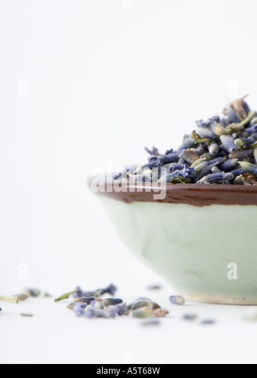 Dried lavender in bowl - Stock Image