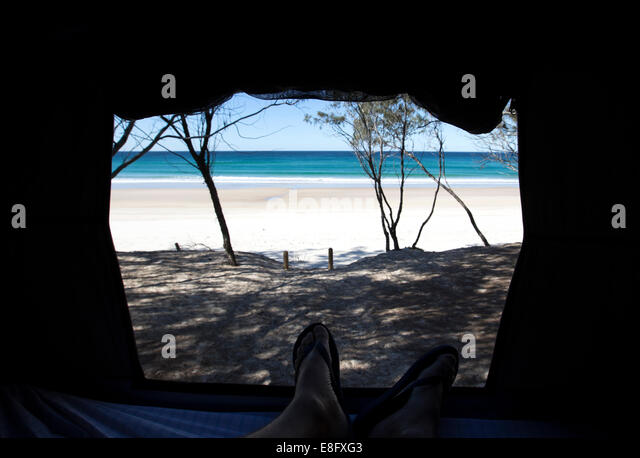View of beach from inside a tent - Stock Image